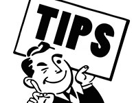 "man with ""tips"" sign"
