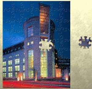 Library Puzzle in progress; photograph is of the Health Sciences and Human Services Library at night.