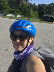 Headshot of library staff on bike with helmet