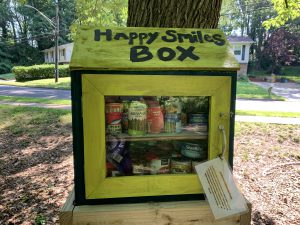 Happy Smiles Box photograph with canned goods and non-perishables for the community