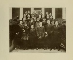 Group photograph of 28 students in front of a building.
