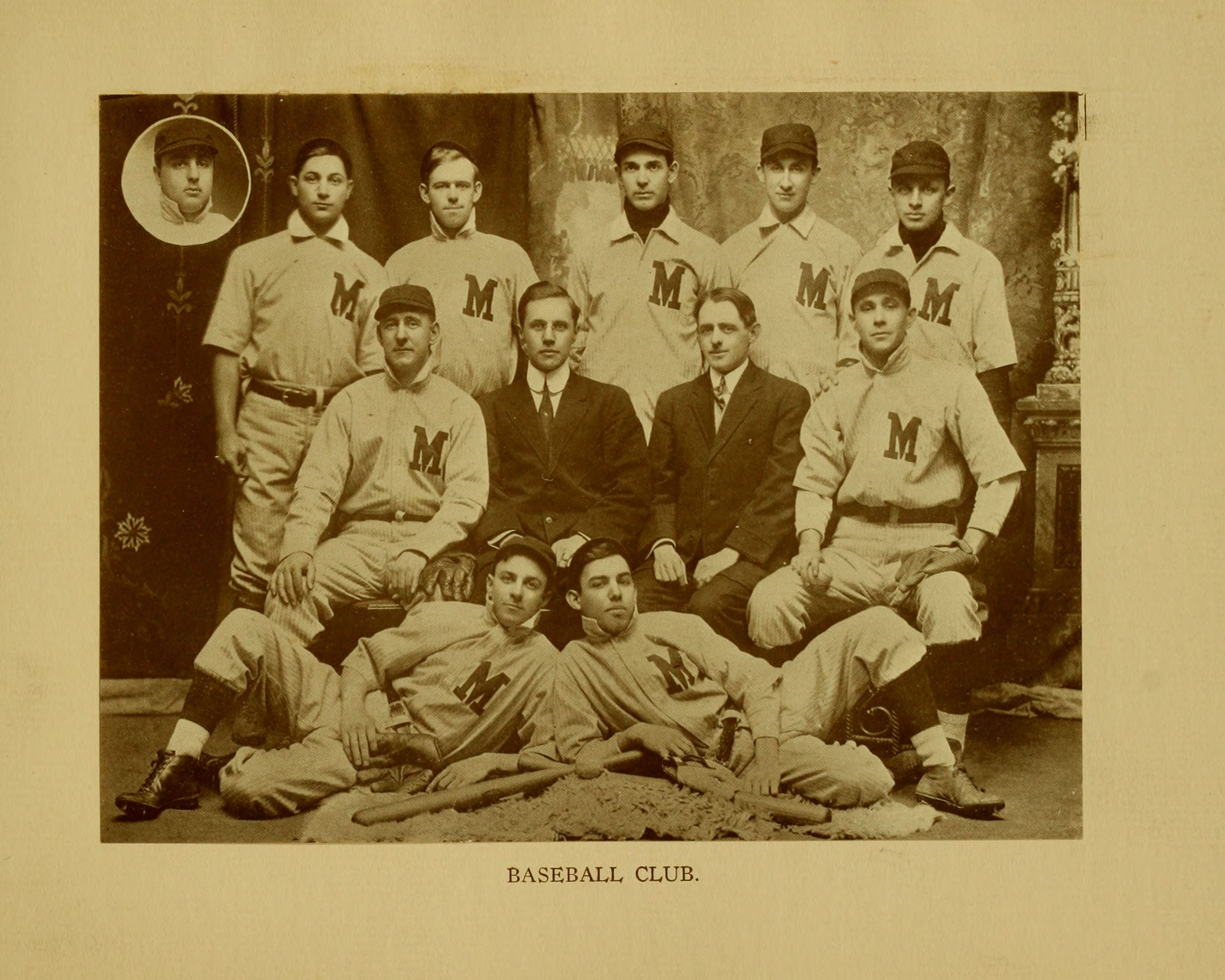 Black and white photograph of a group of men in baseball gear.