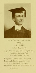 Black and white yearbook photograph of man in cap and tassel.