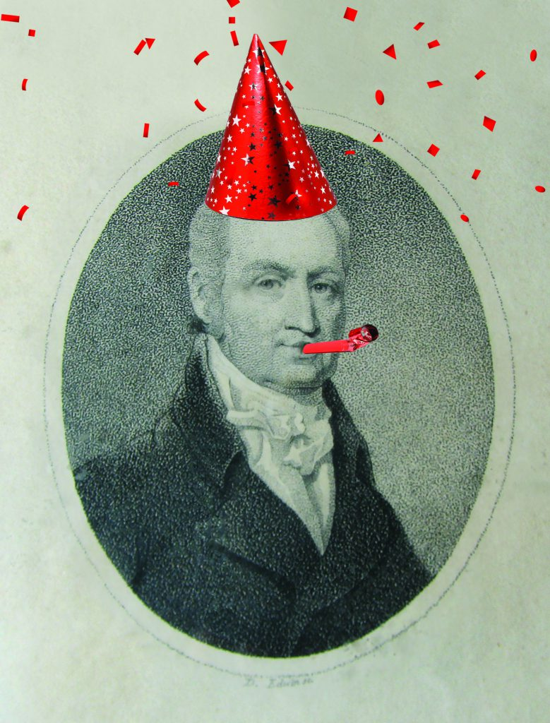 Photograph of Dr. John Crawford, man with a suit and tie, with a silly birthday hat, confetti, and birthday noisemaker photoshopped on the image