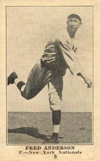 Black and white photograph of a man in baseball uniform throwing a ball.