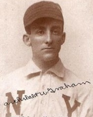 Black and white photograph of man in baseball uniform.