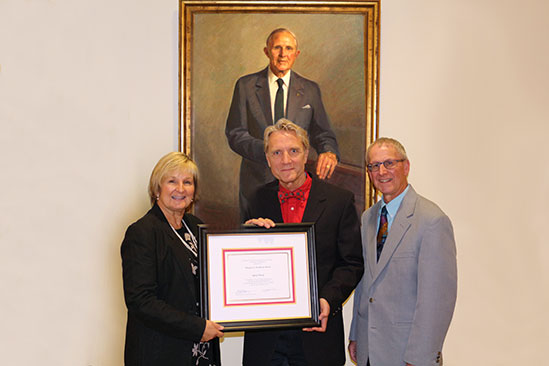 The Library presented its Theodore E. Woodward Award to Larry Pitrof, Executive Director of the Medical Alumni Association